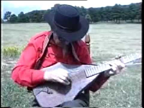 JIMMY DRIFTWOOD playing on his famous homemade guitar